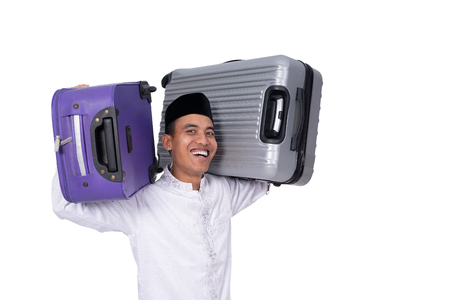 muslim asian man with suitcase