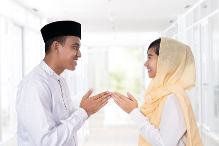 muslim woman hand touching greeting 스톡 콘텐츠