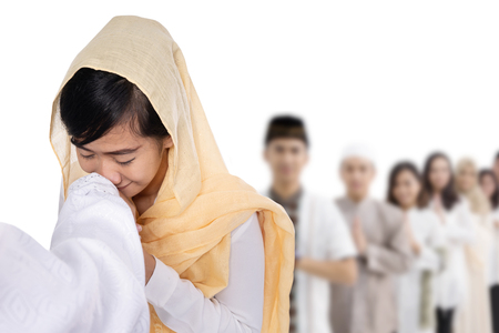 muslim woman with hijab kissing hand