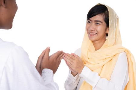 muslim woman hand touching greeting Stock Photo