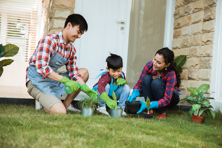 parent and son gardening activity outdoor in the garden house