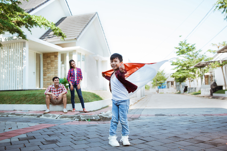 kid holding flag celebrating independence day