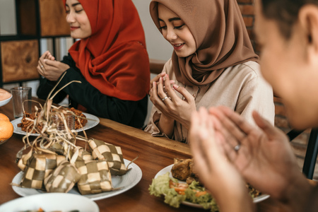 muslim people praying before break fasting