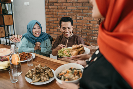 muslim people having some food together