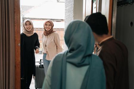 muslim family and friend embrace eid mubarak