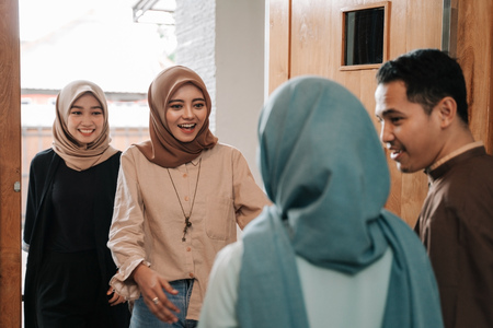 muslim family and friend embrace eid mubarak Stock Photo