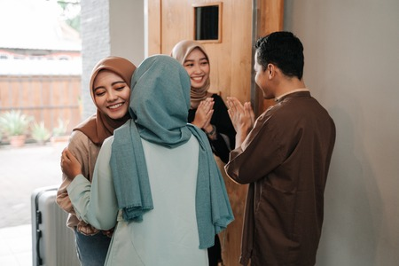muslim family and friend embrace eid mubarak