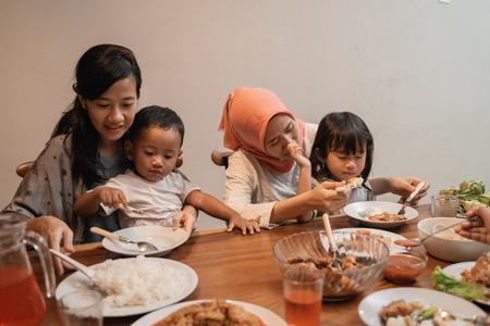 mother feeding their child on dinner
