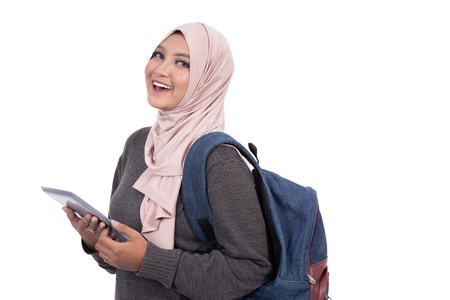 muslim student with tablet pc