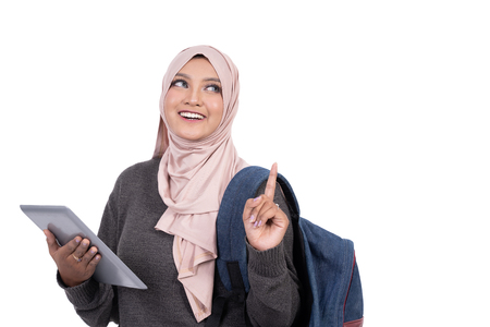 muslim student with tablet pointing and thinking