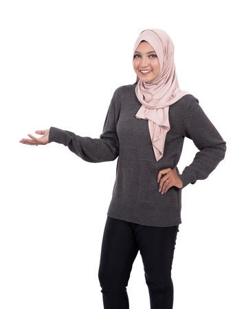 happy smiling muslim woman presenting