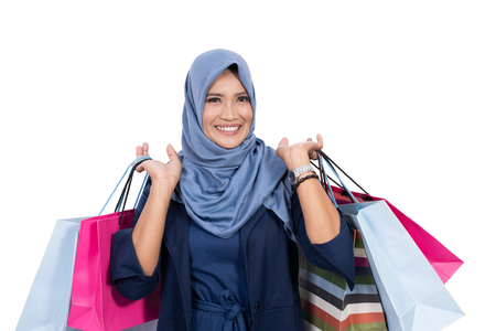 mature muslim woman with shopping bag