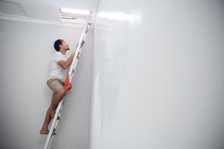 man repair the broken ceiling