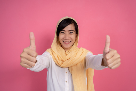 woman muslim asian showing thumb up