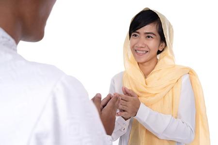 muslim woman hand touching shake hand