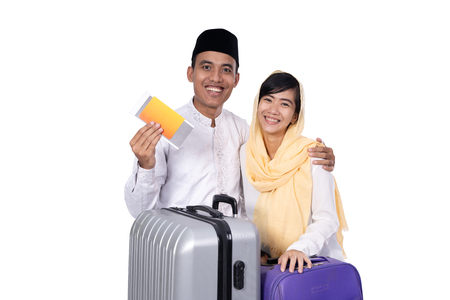 muslim asian couple with travel suitcase