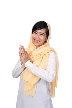 muslim asian woman greeting gesture