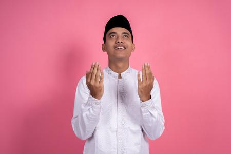 muslim man open arm pray gesture