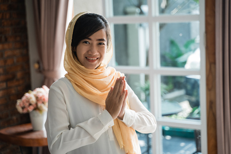 woman asian islam gesture of welcome Stock Photo