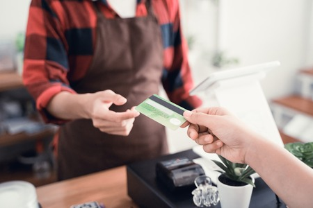 man worker in cafe counter receiving payment