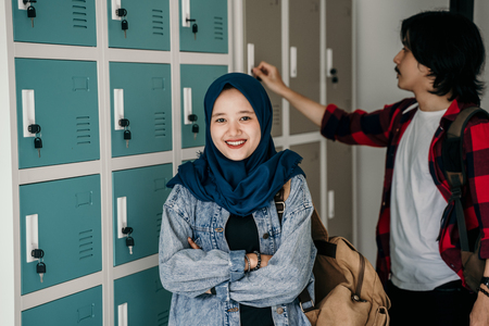 muslim asian student friend in locker room