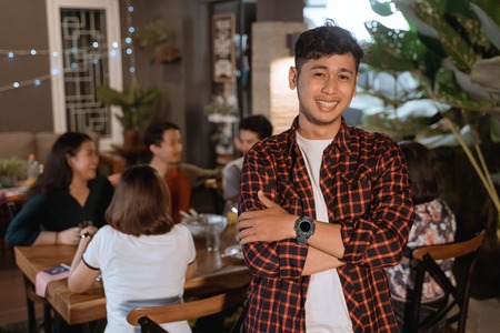 man crossed his arm and looking camera while dinner outdoor Stock Photo