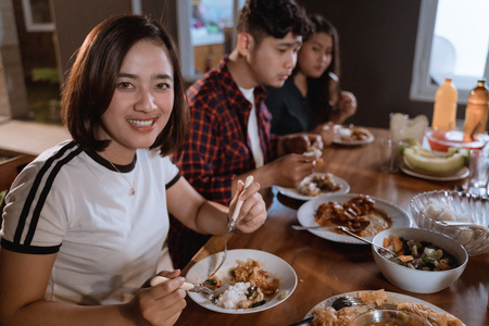 beautiful asian woman smiling to camera while having dinner at backyard Stock Photo