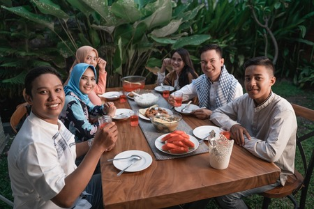 Happiness of frienship when enjoy eating iftar together Imagens