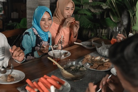 Happiness of frienship when enjoy eating iftar together Stock Photo