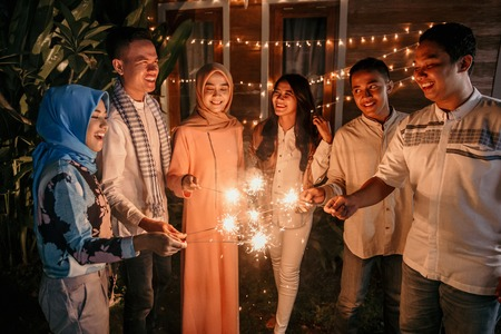 Playing firework with friends Stock Photo