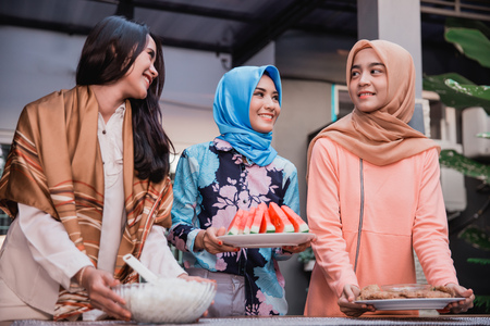 young hijab woman prepare cuisine for breaking fast serve to friends in the house at afternoon Stock Photo