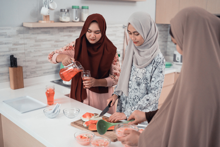 muslim woman family preparing for iftar break fasting