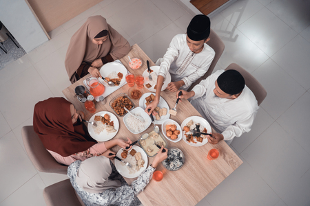 top view muslim family enjoy the iftar meal dinner