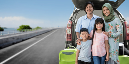 asian muslim family travelling concept