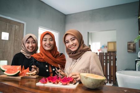 three hijab woman smiling when prepare fruits slice Stok Fotoğraf