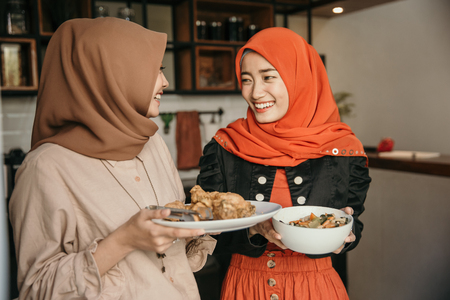 woman and her friend preparing food for breaking fast