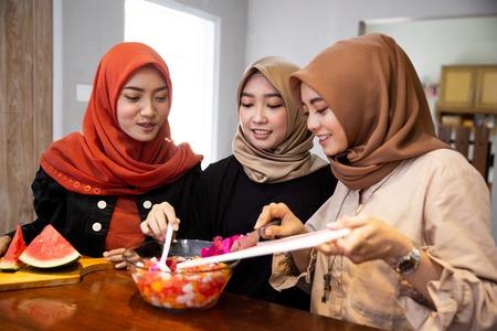 women hijab prepare fresh drink cocktail