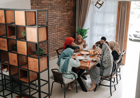 Family members gather in the dining room together when breaking fast