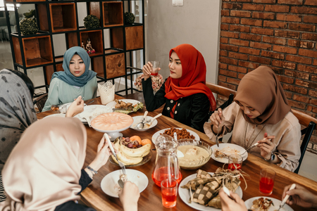 Family members when breaking fast together in the dining room