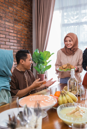 The Hijrah family together enjoy the iftar meal Stock Photo