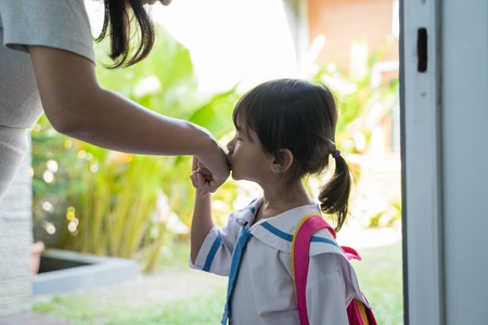 kid kiss her mothers hand before going to school Stok Fotoğraf - 123731343