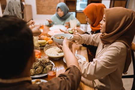 Portrait hijrah family when breaking fast together in the afternoon