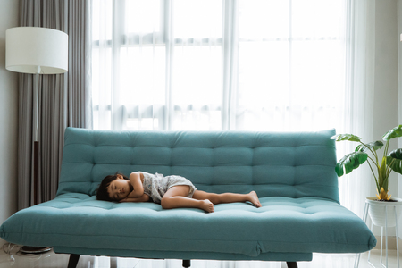 little girl sleeping on a comfortable sofa