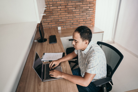 man works with a laptop Stok Fotoğraf