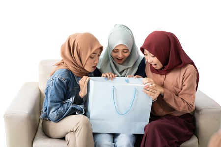 muslim woman with shopping bag isolated