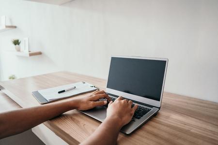 male hand typing on laptop Stok Fotoğraf