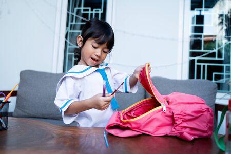 happy toddler with school uniform preparing her self for school Standard-Bild