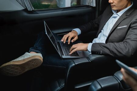 businessman with tablet sitting on passenger seat