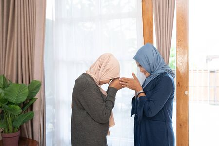 daughter and mother greet each other apologizing