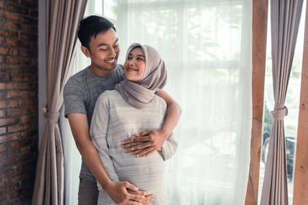 pregnancy muslim woman with husband Archivio Fotografico